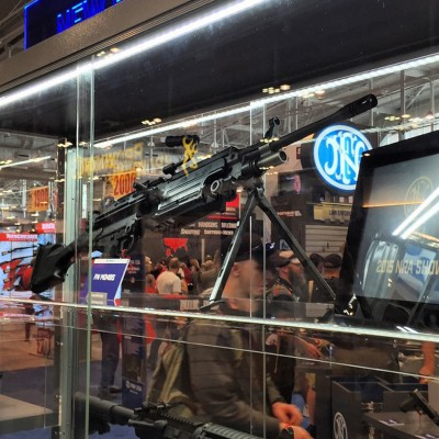 FN semiautomatic SAW rifle behind a glass case at the NRA Meetings & Exhibits