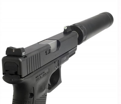Tritium front and SilencerCo serrated U-notch rear sights on a suppressed gun
