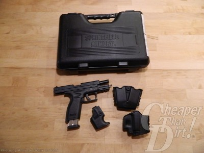 Black pistol case, Springfield XD 9mm pistol, magazaine loader, holster, and magazine holder