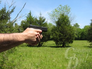 Close up of a man pointing a Glock 42 down range