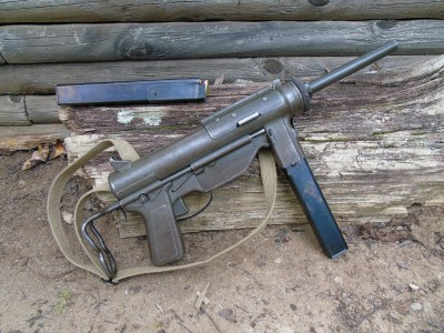 A surplus submachine Grease Gun