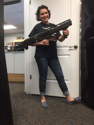Woman with double-barreled DP-12 semiautomatic shotgun