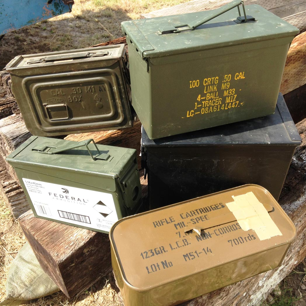 Metal military surplus ammo cans stacked up