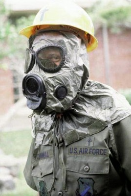 Man in protective suit with built in gas mask