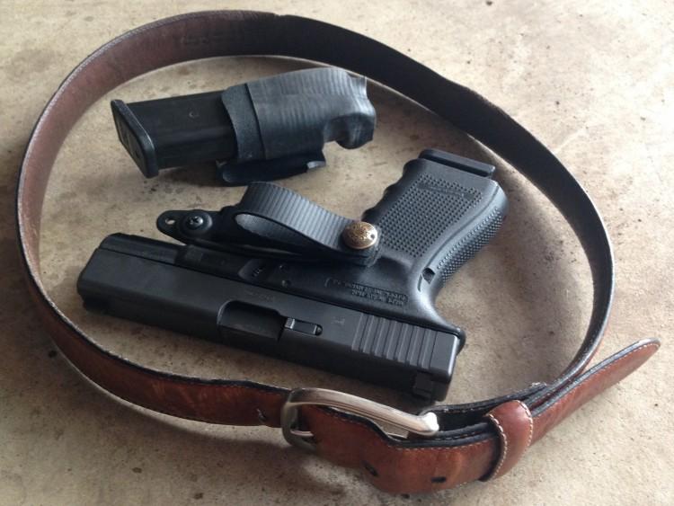 Glock 19, brown leather gun belt and mag holder