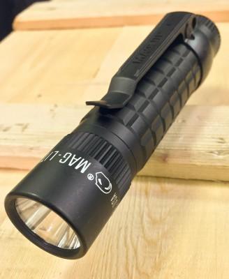 Black, knurled Maglite MAG-TAC compact flashlight
