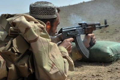 Afghan policeman training with his AK-47