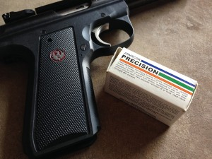 Box of Armscor ammo and the grip of a Ruger pistol