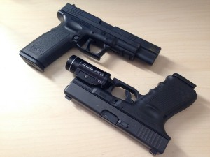 Glock and Springfield XD handguns side by side