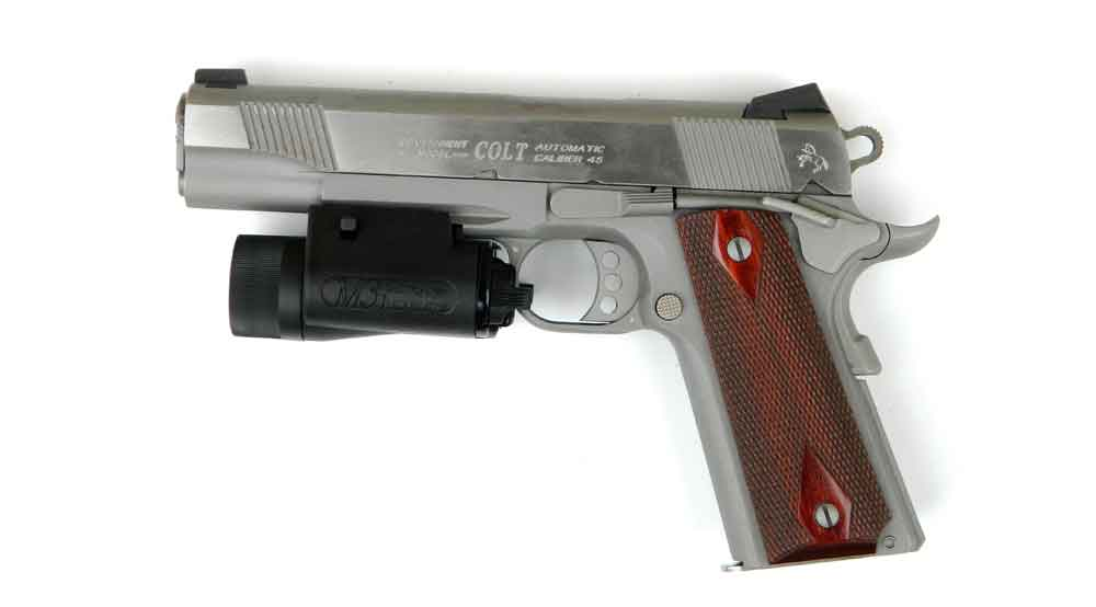 Colt Government Model pistol in stainless with light on rail