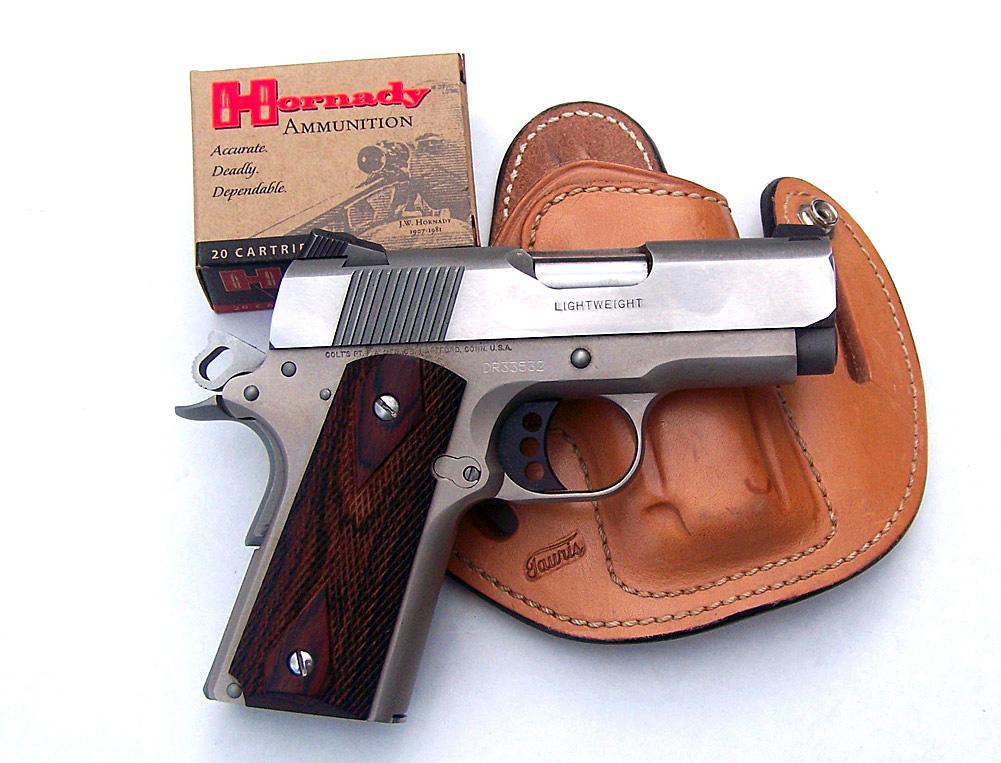 Colt Defender with Hornady ammunition box