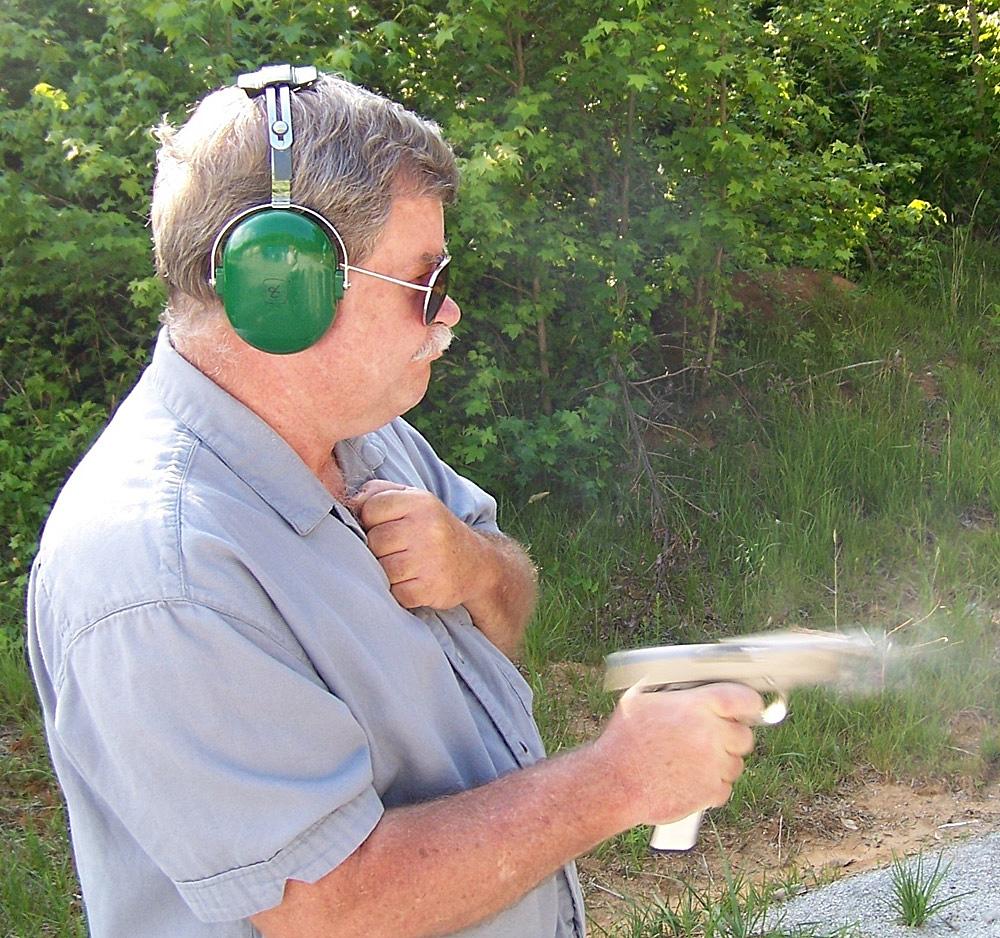 Bob Campbell firing the Colt Defender
