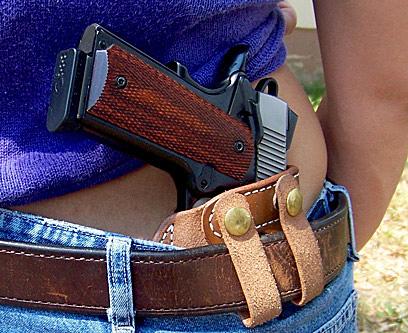 Woman carrying 1911 pistol inside the waistband