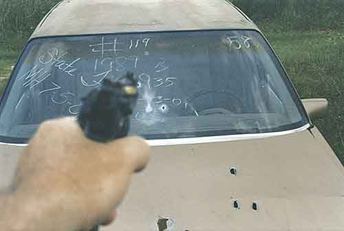 Shooting a handgun through a car windshield