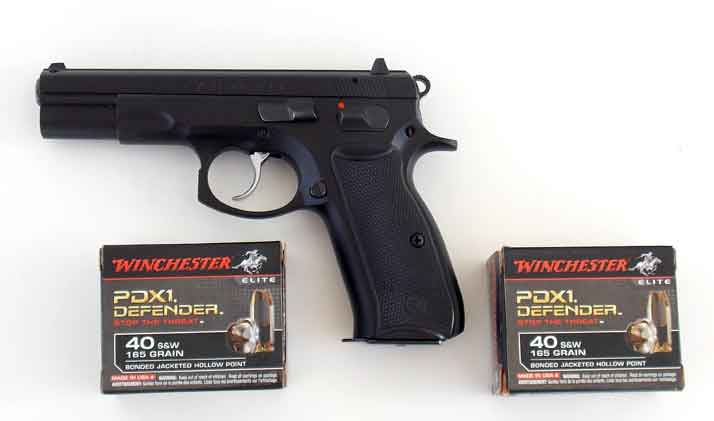 CZ 75 pistol with two boxes of Winchester PDX1 Defender ammunition