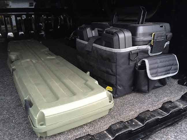 Gun cases in back of pickup truck with camper shell