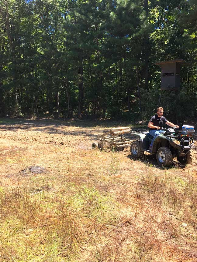 Man plowing a field with an ATV