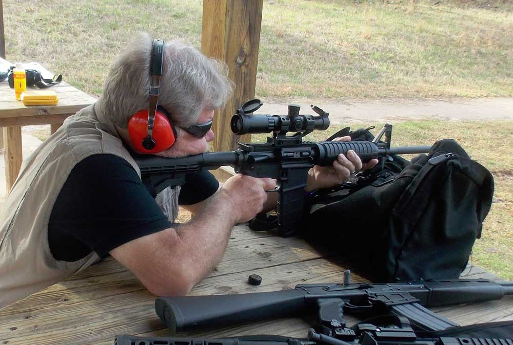 Bob Campbell shooting Colt rifle with Truglo scope
