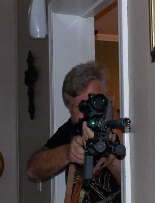 Bob Campbell with AR-15 Shooting out of a doorway