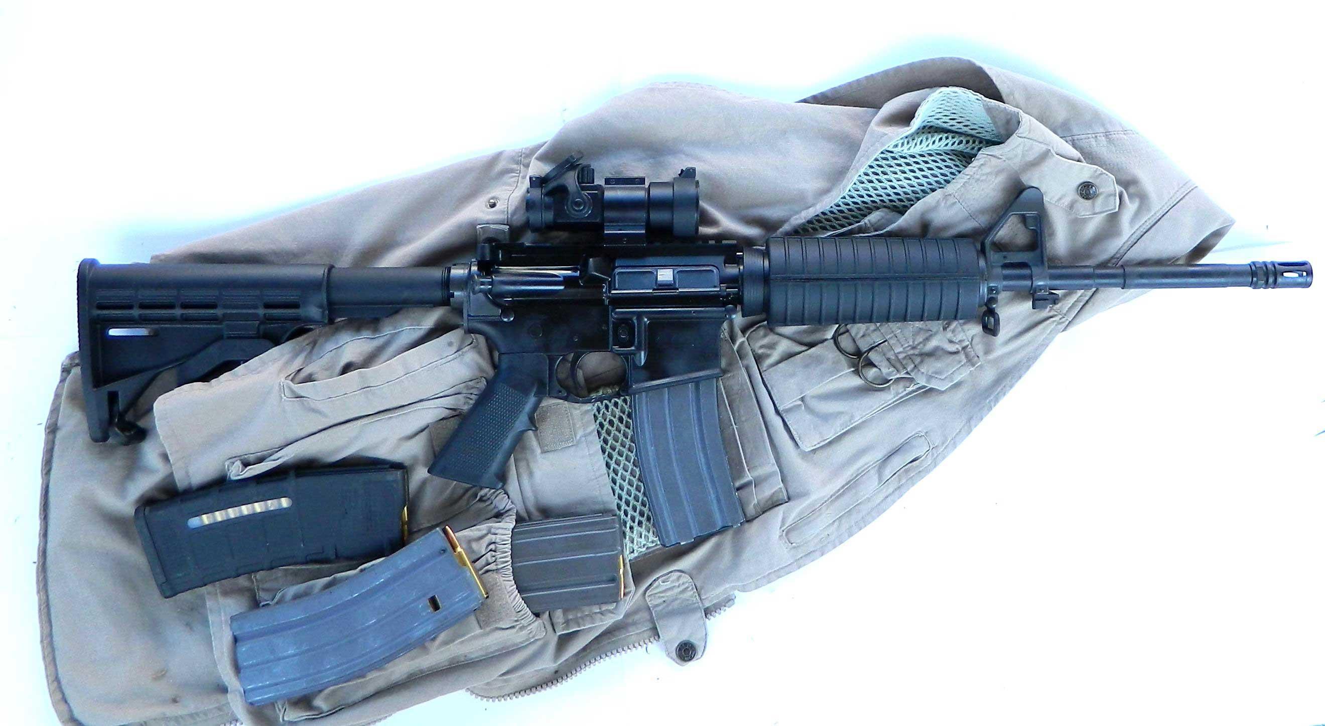 CORE 15 rifle on khaki vest