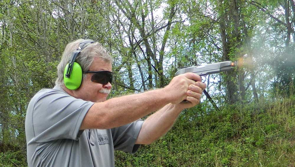 Bob Campbell Shooting a 1911 handgun