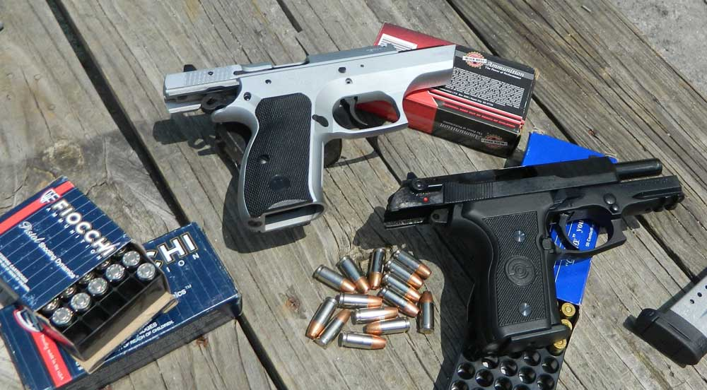 TriStar T100 and Stoeger Cougar handguns with ammunition boxes