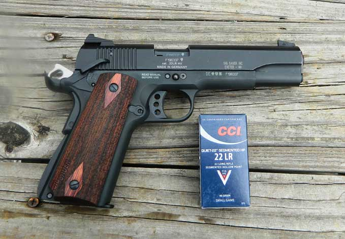 SIG 1911-22 handgun with a box of CCI .22 LR ammunition