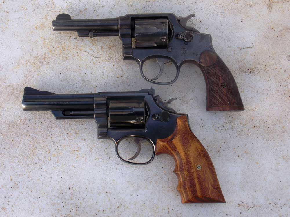two revolvers with wood grips