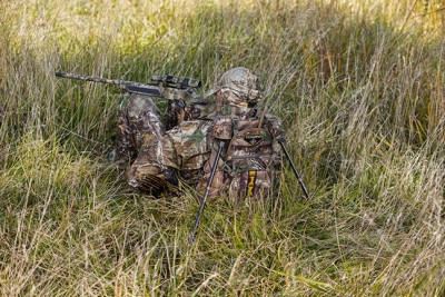 Turkey hunter wearing camouflage with shotgun
