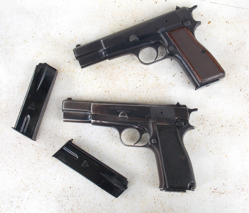 Two Browning High Power handguns and magazines