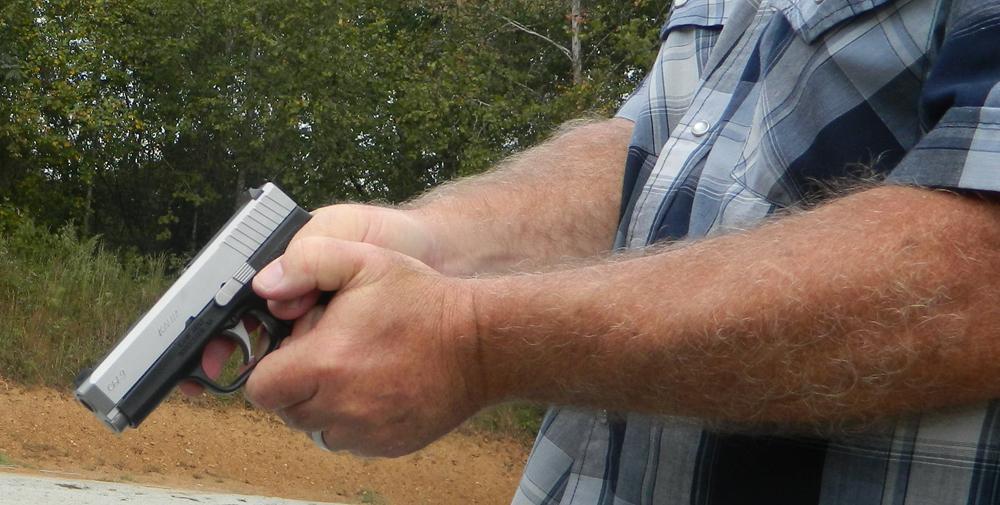 man gripping handgun
