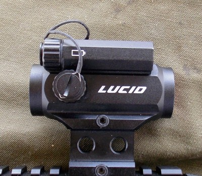tethers on adjustment and battery caps on Lucid M7 sight