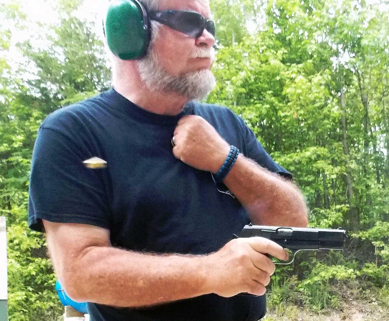 firing a handgun from the retention position
