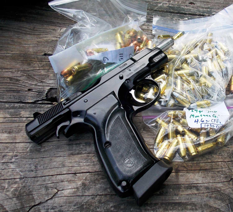 pistol on bags of ammuniton