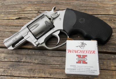 Charter Arms with a box of Winchester #12 ammunition