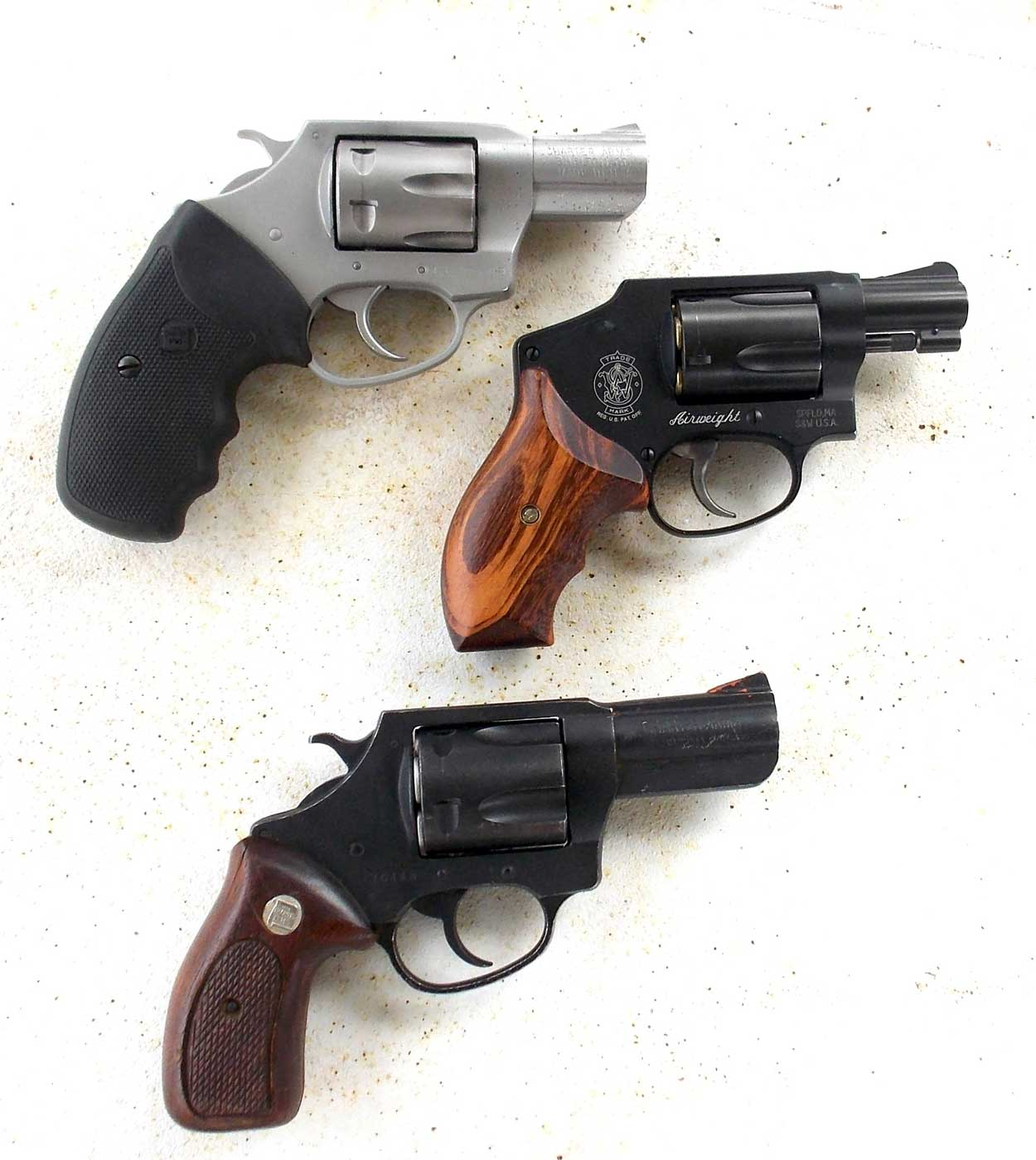 Charter Arms Pathfinder .22, Smith and Wesson 442 .38, and Charter Arms Bulldog .44 Special revolvers