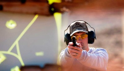 Target's view of man firing a pistol