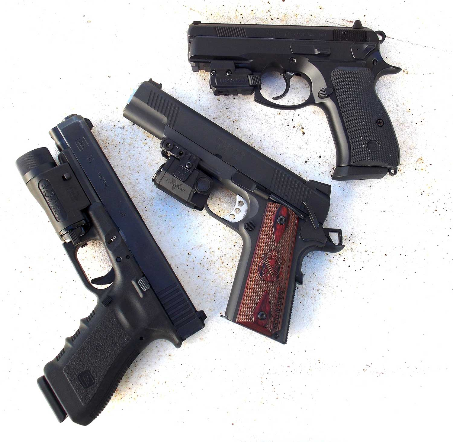 Rail guns top to bottom - CZ with Lasermax laser, Springfield with Viridian light and Glock with Insights light.