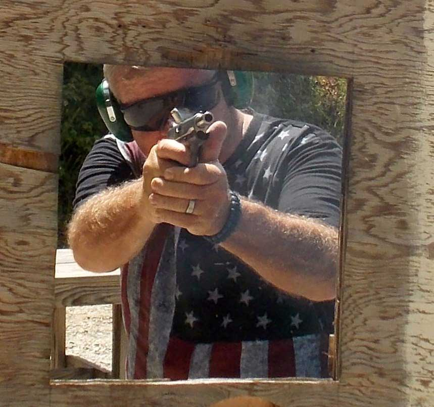 Bob Campbell shooting the Ruger SR1911 pistol through a barricade