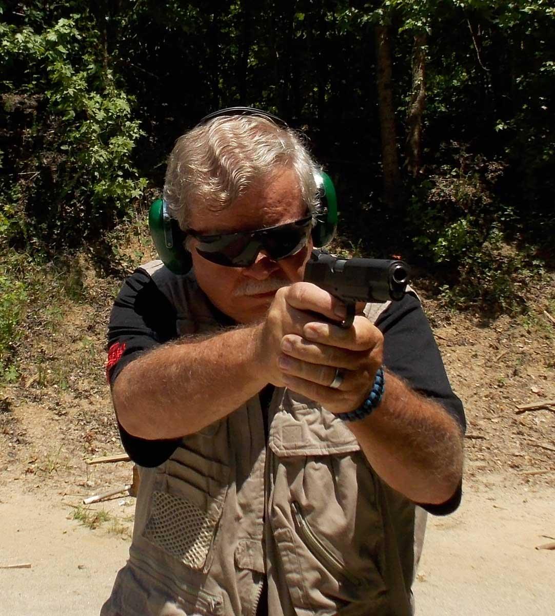 Posed to shoot Springfield's Range Officer 1911 pistol