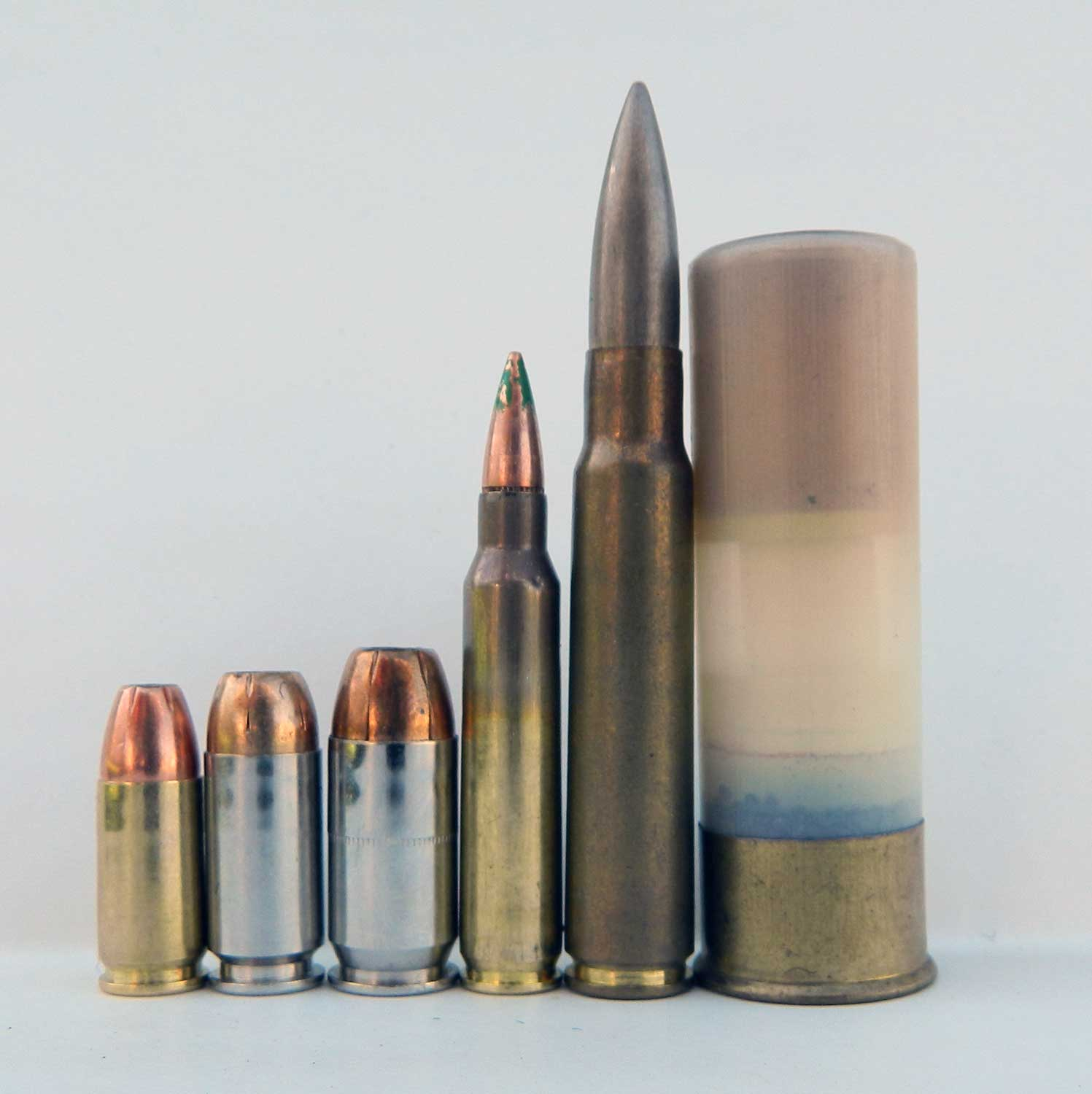 Multiple cartridges ranging from 9mm to 12 gauge