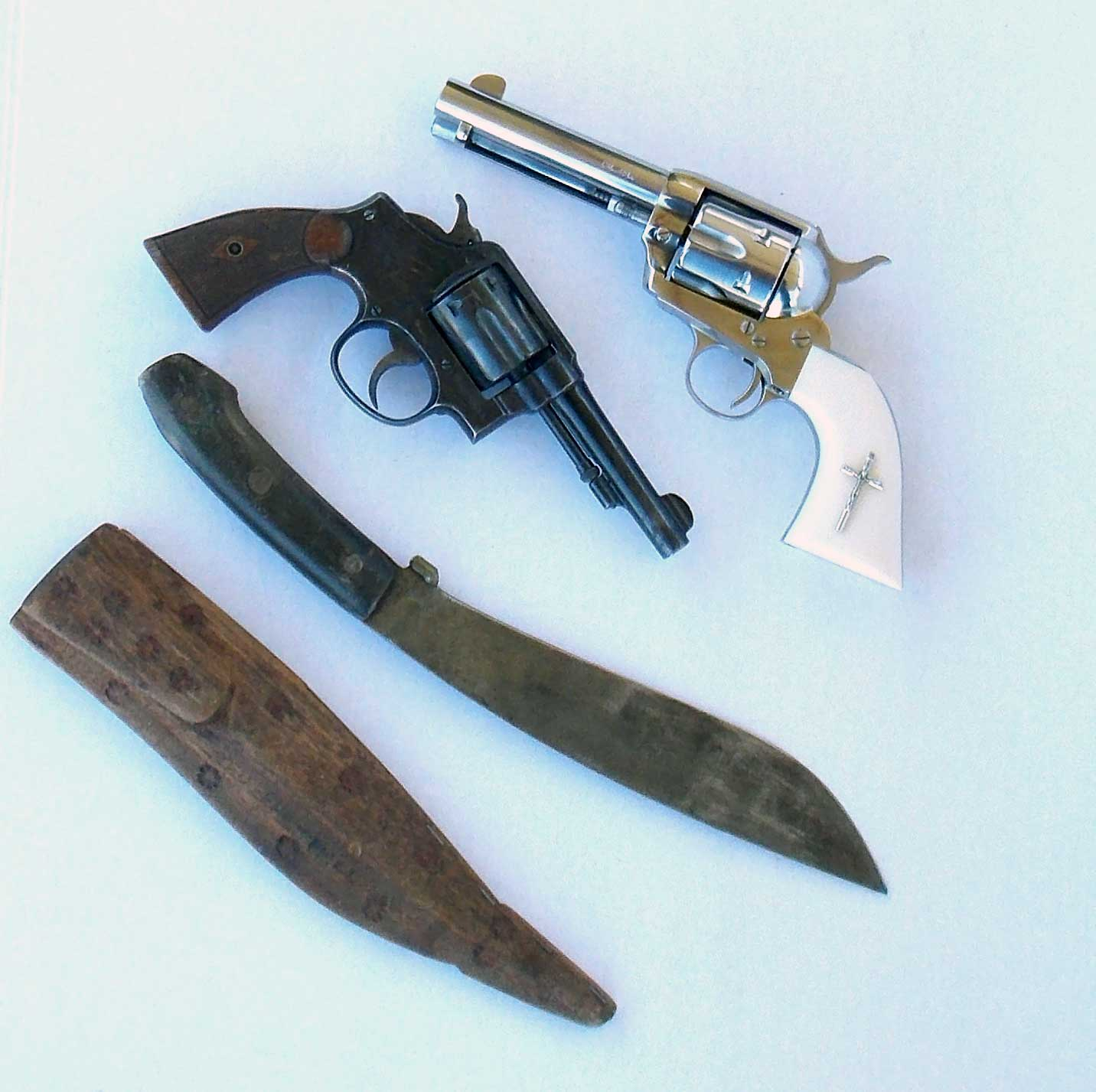 .38 caliber revolvers with a Philippine Bolo