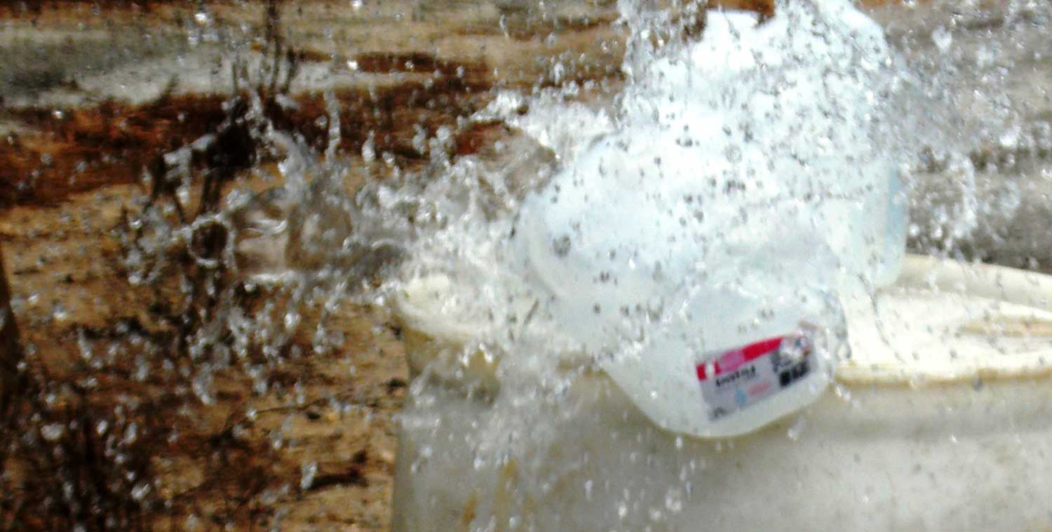 Water jug exploding after being shot by a 9mm