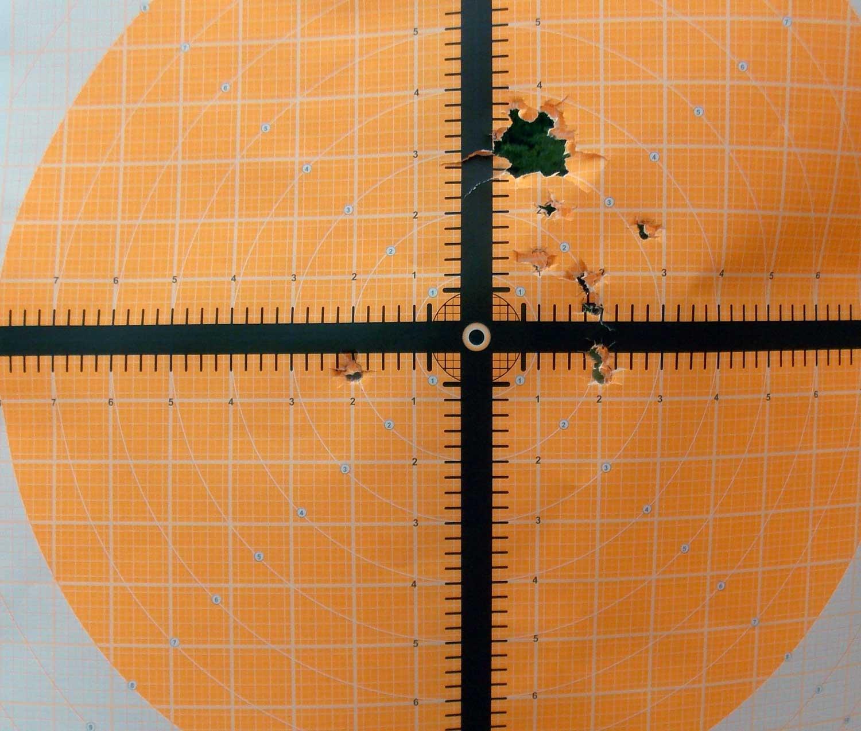 Orange target with holes from buckshot