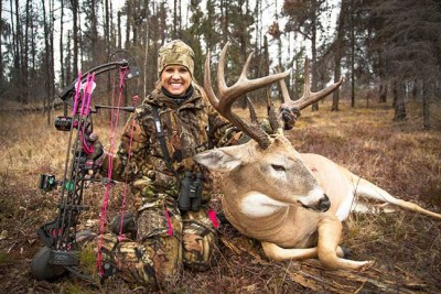 Woman with trophy whitetail buck