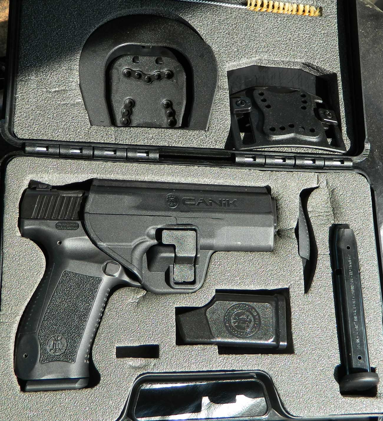 Canik 55 pistol, case, and accessories