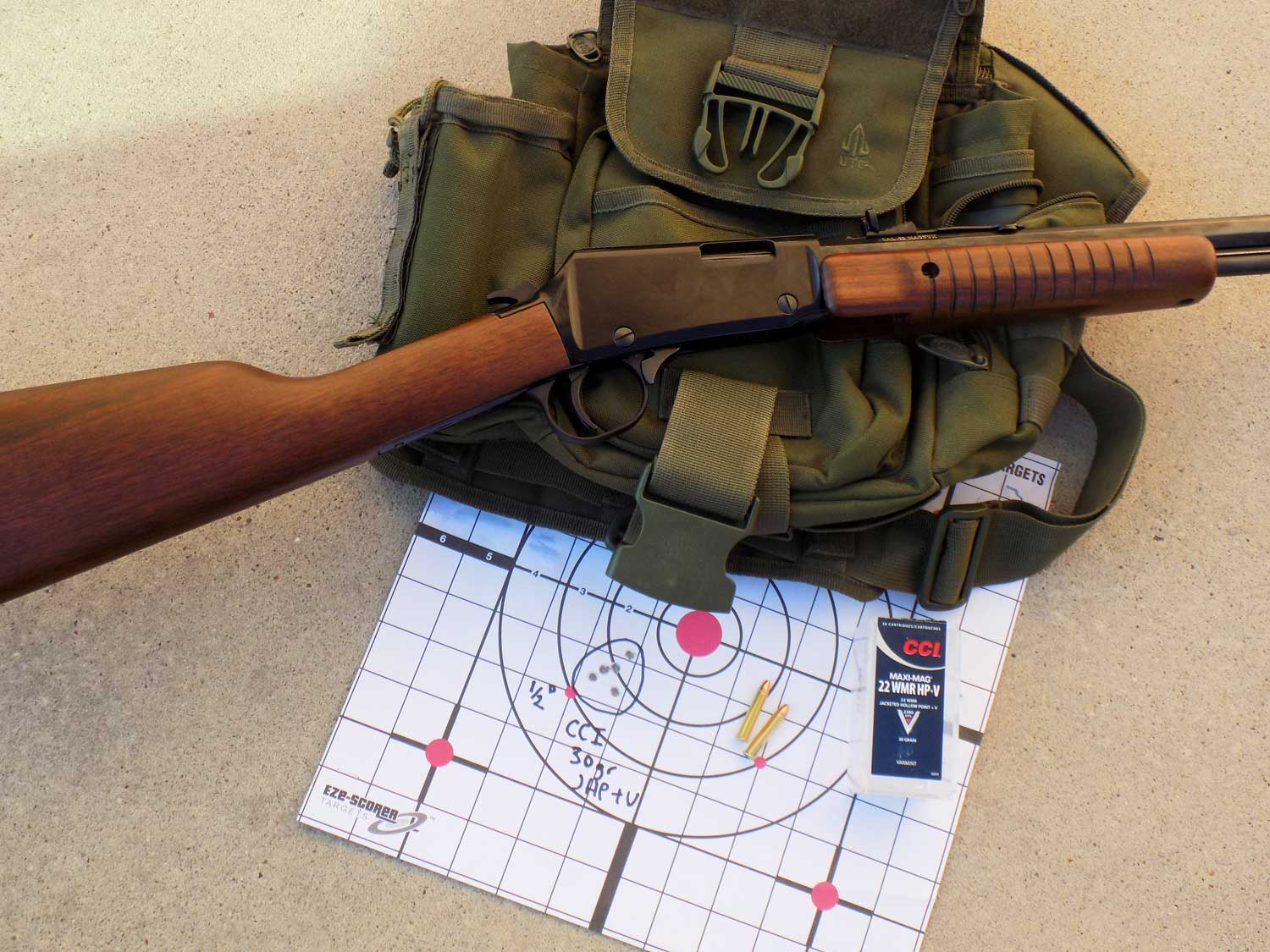 Henry Pump Octagon on OD green pack with paper target and CCI ammuniton
