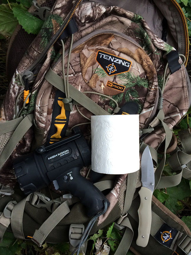 Pack, knife, toilet paper and flashlight