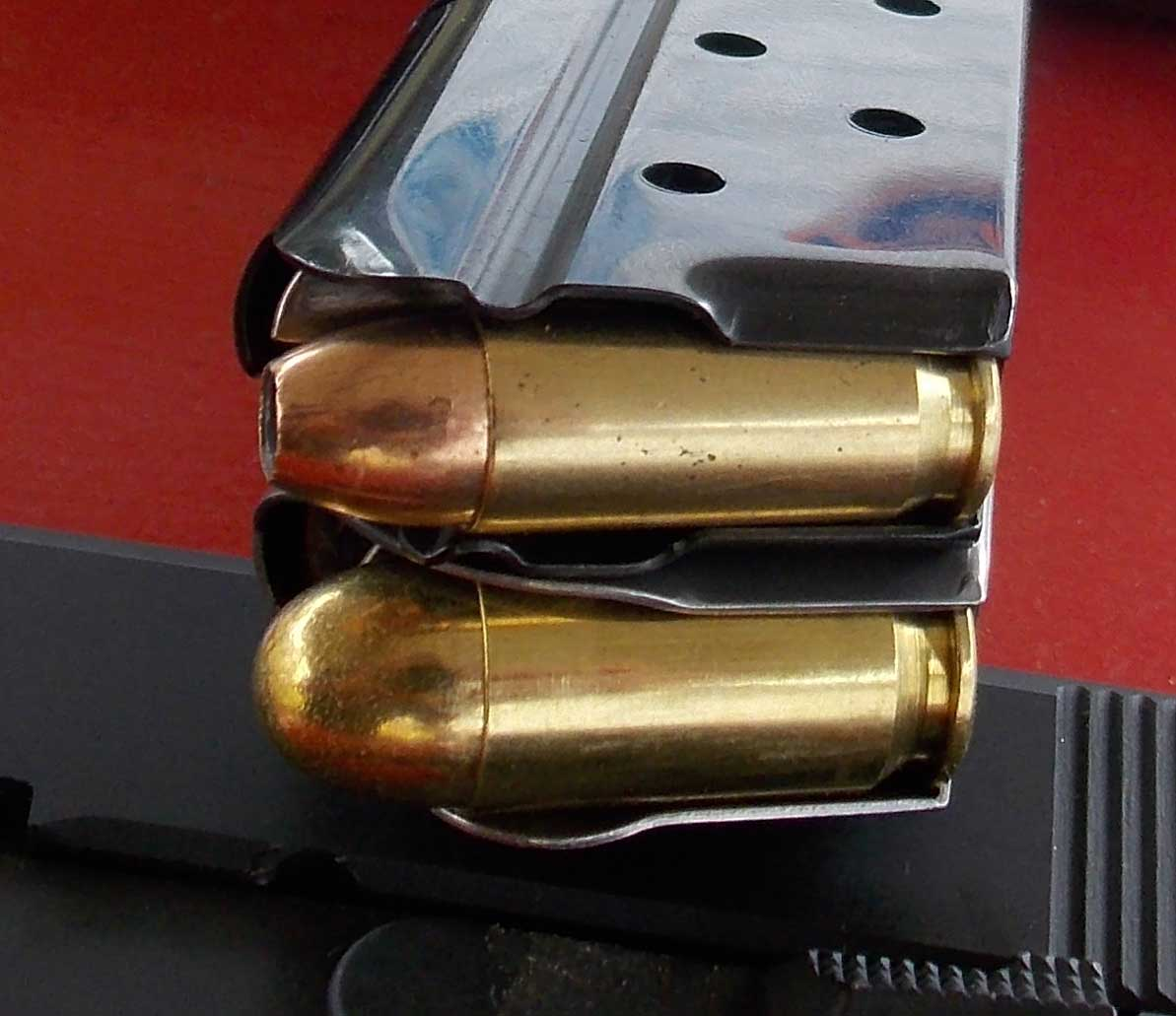 .38 Super magazine, above, .45 ACP, lower.