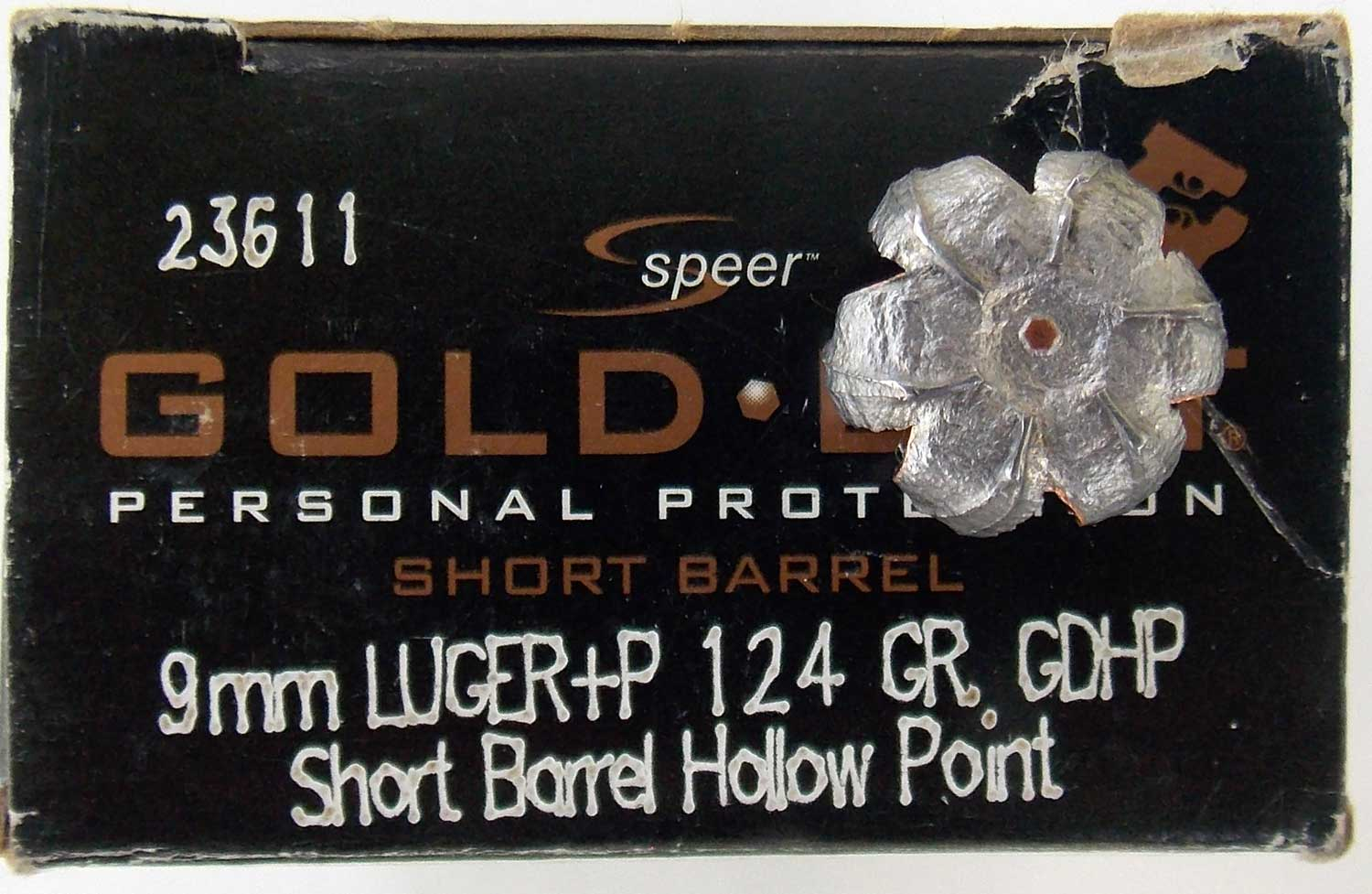 Upset Speer Gold Dot 124-grain +P short barrel load on ammunition box